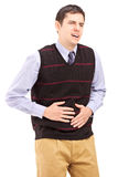 Young man having a stomach ache. Isolated on white background Stock Image