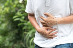 Young man having a stomachache stock images