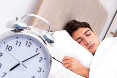 The young man having trouble waking up in the morning Royalty Free Stock Images