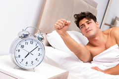 The young man having trouble waking up in the morning Royalty Free Stock Photo