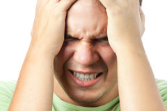 Young man having very strong pain isolated Royalty Free Stock Photo