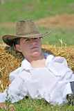 Young man on hay bale Royalty Free Stock Images