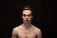 Young man head face closeup jawline. Young adult man model head face shoulders shirtless closeup jawline royalty free stock photos