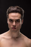 Young man head face closeup jawline. Young adult man model head face shoulders shirtless closeup jawline royalty free stock photography