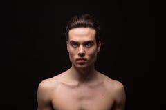 Young man head face closeup jawline. Young adult man model head face shoulders shirtless closeup jawline stock photos