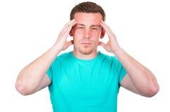 Young man with a headache. Man has heavy headache and needs medicine Stock Photo