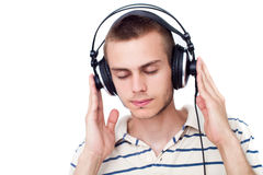 Young man with headphone. Relaxed young man listening to music on headphone Royalty Free Stock Image