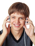 Young man with headphones. Royalty Free Stock Photo