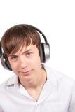 Young man with headphones. Young man with headphones on white background Stock Photos