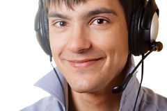 Young man in headphones. Against white background Stock Photography
