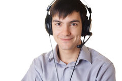 Young man in headphones. Against white background Royalty Free Stock Photography