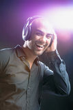 Young man with headphones on Royalty Free Stock Photo