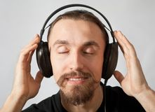 Young man in headphones with closed eyes Royalty Free Stock Images