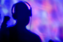 Young man with headphones in a dance club Royalty Free Stock Photo