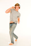 Young man with headphones dancing Stock Photos