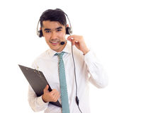 Young man in headphones holding a folder Stock Images