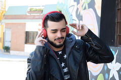 Young man with headphones. Stock Photo