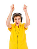 Young Man in Headphones. Listen to the Music and Dance Isolated on the White Background Royalty Free Stock Photography