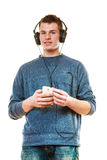 Young man with headphones listening music Royalty Free Stock Image