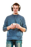 Young man with headphones listening music Stock Photography