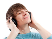 Young man with headphones listening to music Stock Images