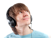 Young man with headphones listening to music Royalty Free Stock Image