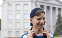 Young man with headphones listening to music. In the park Stock Photo
