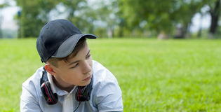 Young man with headphones listening to music. Pensive Young man with headphones listening to music Royalty Free Stock Photos