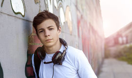 Young man with headphones listening to music Royalty Free Stock Photography