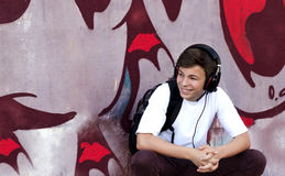 Young man with headphones listening to music. Stylish young man in headphones listening to music Royalty Free Stock Photos