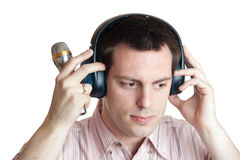 Young man with headphones and microphone Stock Photos