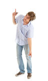 Young man in headphones pointing Royalty Free Stock Photography