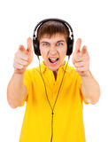 Young Man in Headphones. Pointing on You Isolated on the White Background Royalty Free Stock Image
