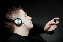 Young man with headphones use mp3 music player Royalty Free Stock Photos
