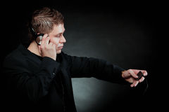 Young man with headphones use mp3 music player Stock Images