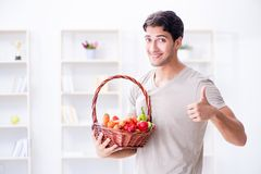 The young man in healthy eating and dieting concept. Young man in healthy eating and dieting concept Stock Photo