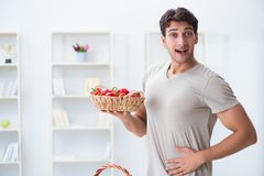 The young man in healthy eating and dieting concept stock photos