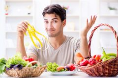 The young man in healthy eating and dieting concept stock photography