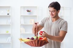 The young man in healthy eating and dieting concept. Young man in healthy eating and dieting concept Royalty Free Stock Images