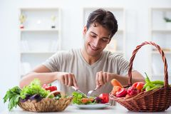 The young man in healthy eating and dieting concept. Young man in healthy eating and dieting concept Royalty Free Stock Photo