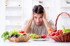 The young man in healthy eating and dieting concept. Young man in healthy eating and dieting concept Royalty Free Stock Photos