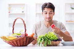 The young man in healthy eating and dieting concept royalty free stock photos