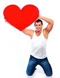 Young man with a heart Royalty Free Stock Photos