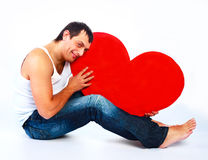 Young man with a heart Royalty Free Stock Photo