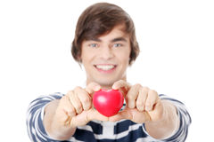 Young man with heart. Royalty Free Stock Image