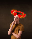 Young man with heart illustrations circleing around his head Stock Photos