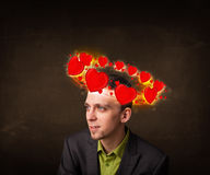 Young man with heart illustrations circleing around his head Royalty Free Stock Photography