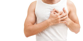 Young man with heart pain gesture, isolated Stock Photography