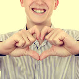 Young Man with Heart Shape Royalty Free Stock Photos