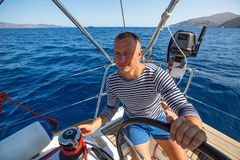 Young man at the helm of his yacht. Sport. Young man at the helm of his yacht royalty free stock image
